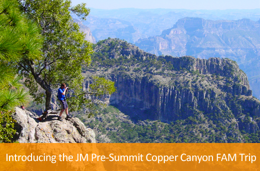 man taking photo of the copper canyon