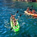 A family kayaking on the seas of Baja California